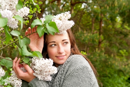 beautiful young woman with lilacs photo