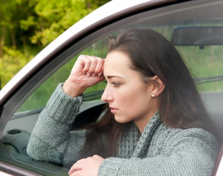 thoughtful young woman in the car Stock Photo - 13859514
