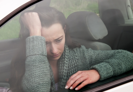 sad young woman in the car photo