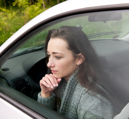 thoughtful young woman in the car Stock Photo - 13859496
