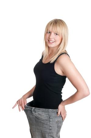 przewymiarowany: Piękny młodych blond kobieta z ogromnymi spodnie Zdjęcie Seryjne