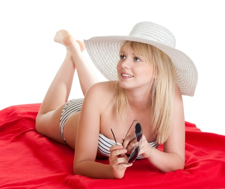 happy young blond woman with hat and sunglasses photo