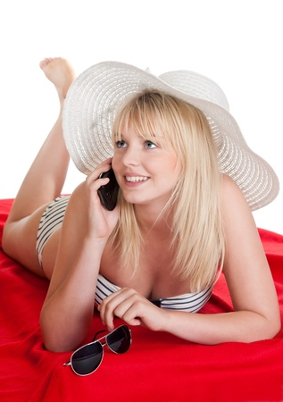 happy young blond woman with mobile phone photo