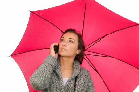 young woman with mobile phone under the umbrella photo