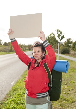 Hitchhiker with blank sign on the roadside Stock Photo - 15782030