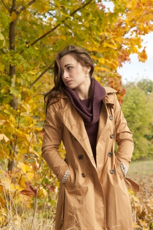thoughtful young woman in autumn park Stock Photo - 16588580