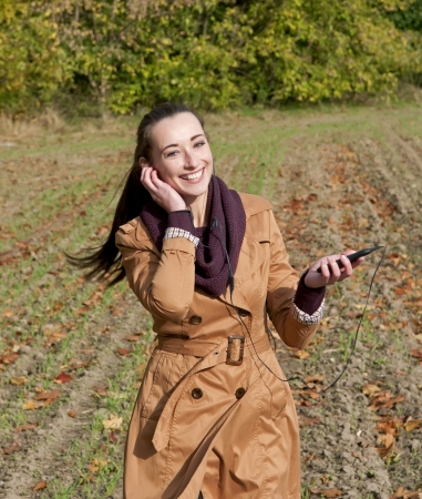 young happy woman listening  music Stock Photo - 16584417