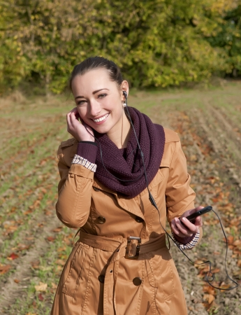 young happy woman listening  music Stock Photo - 16584419