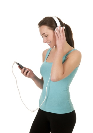 pretty young woman with headphones listening to music photo