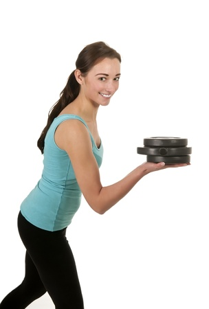 pretty young woman exercising with dumbbells Stock Photo - 17098564