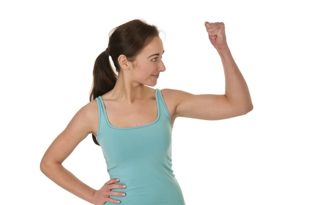 pretty young woman showing her muscles Stock Photo - 17098561