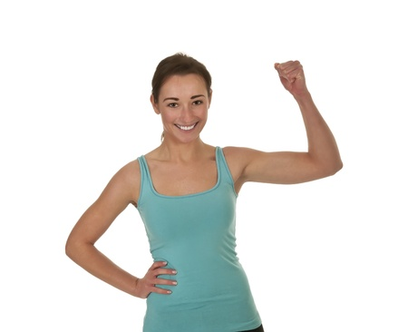 pretty young woman showing her muscles Stock Photo - 17098553
