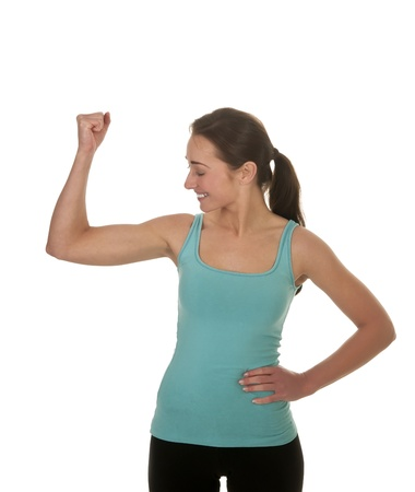 pretty young woman showing her muscles Stock Photo - 17098560