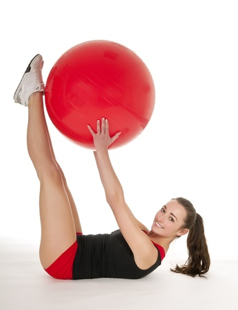 pretty young woman with red gymnastic ball