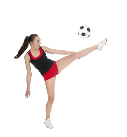 pretty young woman playing with soccer ball photo
