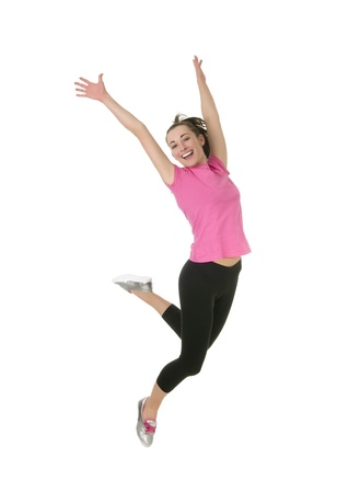 high spirited: cheering young woman jumping in the air