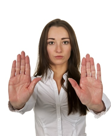 objection:  business woman shows stop with two hands