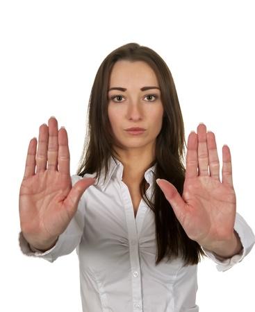 defensa personal: mujer de negocios muestra termina con las dos manos Foto de archivo