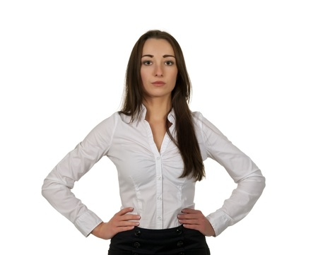 strict businesswoman with arms on hips photo