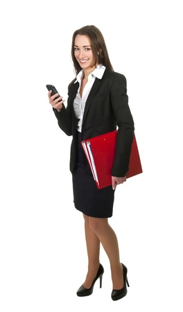 happy businesswoman with cell phone and  red folders photo