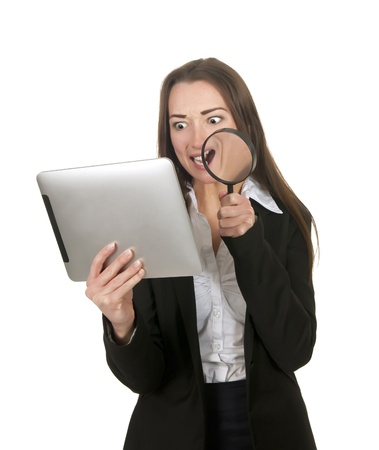 well read: annoyed  businesswoman with tablet pc and magnifying glass Stock Photo