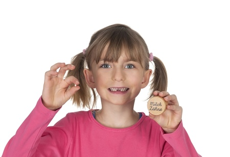 milk tooth:  little girl with tooth gap showing milk tooth Stock Photo