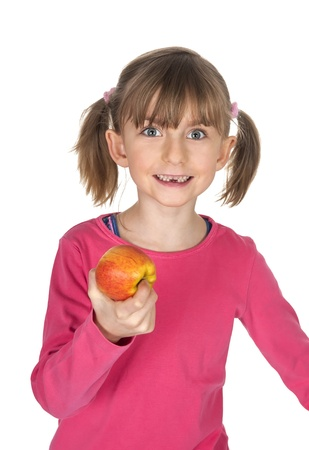 blond little girl with tooth gap eating apple photo