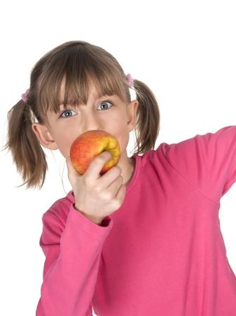blond little girl eating apple photo