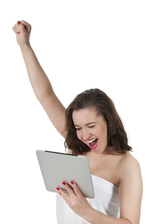 enthusiastic woman with digital tablet cheering Stock Photo - 19607455