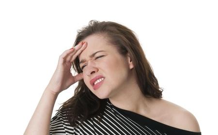 headaches: beautiful young woman has headaches