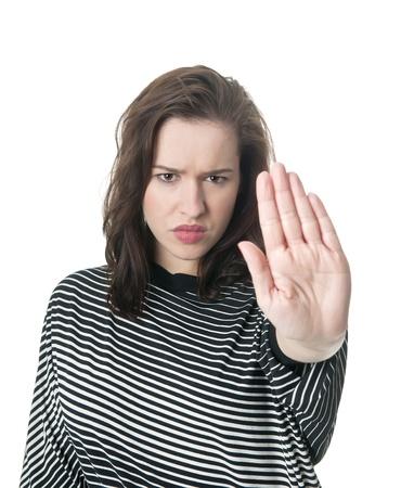 objecion: mujer joven que muestra parada con una mano