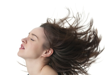 happy young woman with tousled hair photo