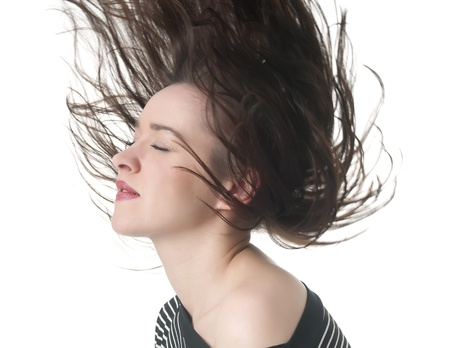tousled: happy young woman with tousled hair