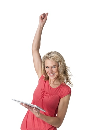 cheering young woman with digital tablet Stock Photo - 19806487