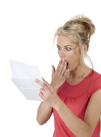 surprised woman gets letter with bad news                photo