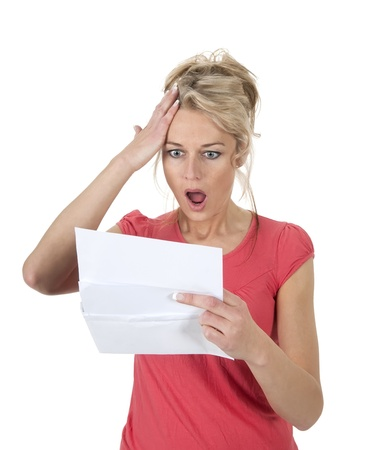 surprised woman gets letter with bad news                Stock Photo