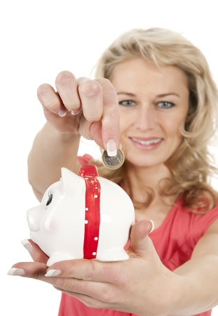 happy young woman with piggybank photo