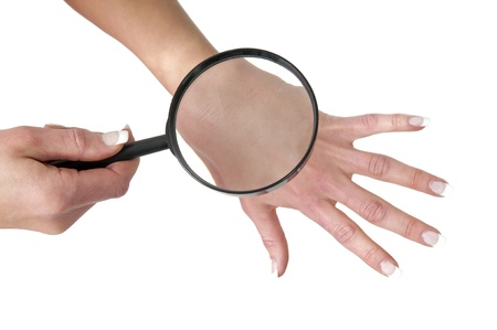 hand, magnifying glass and skin