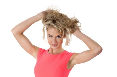 zerzaust: blonde junge Frau mit zerzausten Haaren Lizenzfreie Bilder