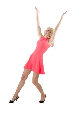 happy young woman in red dress cheering with raised arms Stock Photo - 20047438