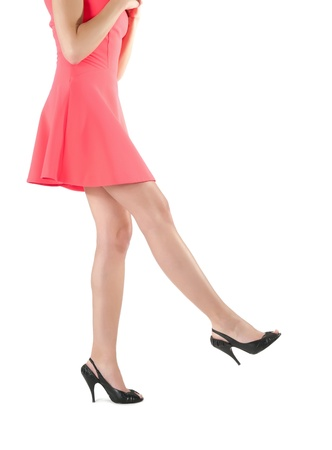 womans legs in red dress Stock Photo
