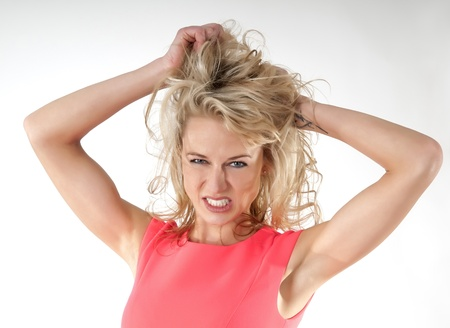 frustrating: angry woman tearing hair