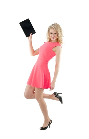 happy woman in red dress walking with tablet pc  Фото со стока