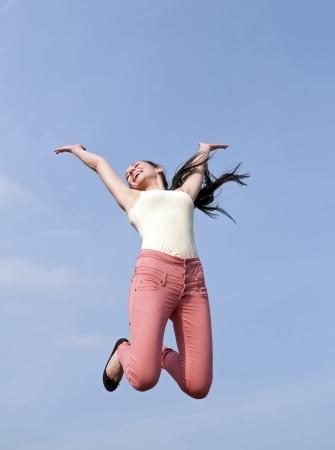 high spirited:  joyful woman leaping Stock Photo