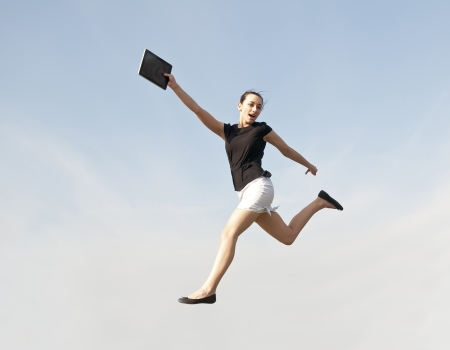 happy business woman jumping with digital tablet Stock Photo - 20364253