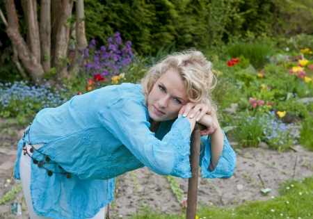 graceful young blond woman  in the garden