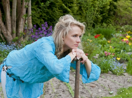 beautiful young blond woman  in the garden Stock Photo