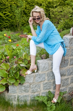 pretty young woman in the garden photo