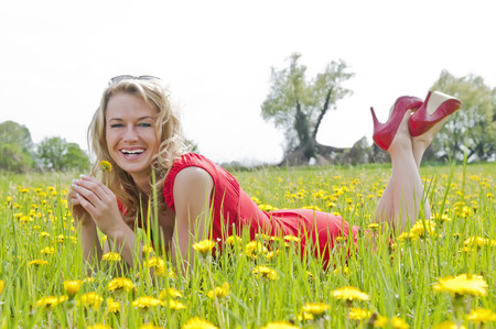 pretty young woman: pretty young woman lying on a meadow Stock Photo