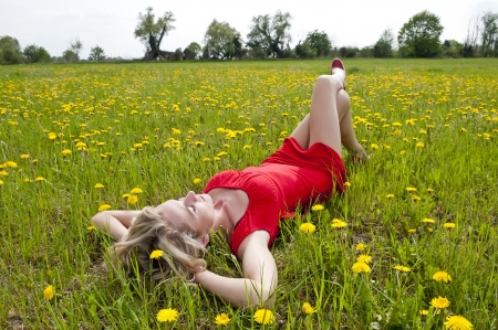 pretty young woman sleeping on a meadow photo